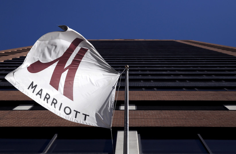 A Marriott flag hangs at the entrance of the New York Marriott Downtown hotel in Manhattan, New York November 16, 2015 (photo credit: REUTERS/ANDREW KELLY)