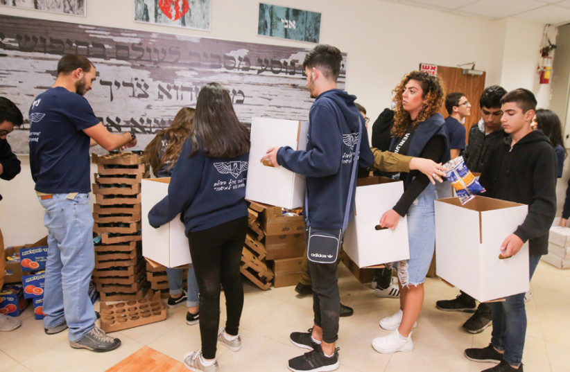 LENDING A hand at SAHI: Meeting for weekly packing and distribution of food packages. (photo credit: MARC ISRAEL SELLEM)