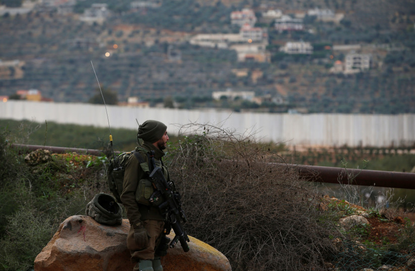"""An Israeli soldier guards near the border with Lebanon, the morning after the Israeli military said it had launched an operation to """"expose and thwart"""" cross-border attack tunnels from Lebanon, in Israel's northernmost town Metula December 5, 2018 (photo credit: REUTERS/Ronen Zvulun)"""
