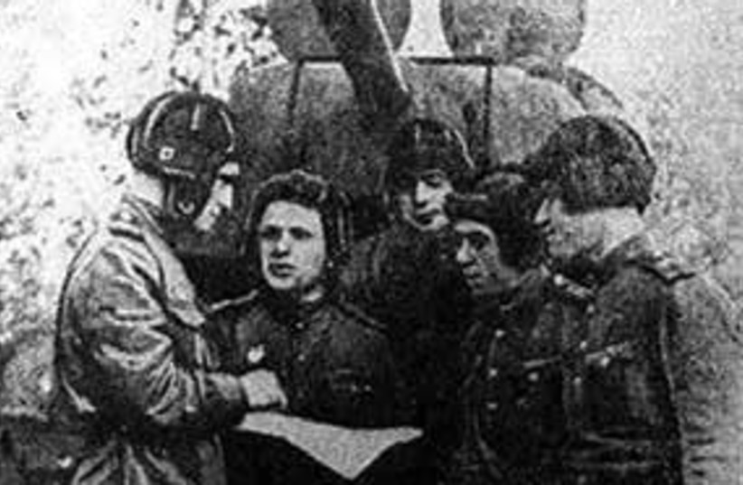 JEWISH SOLDIERS of the 23rd tank brigade.  (Left to right) Mark Kovalev, Matvei Gampel, Sholem Shvartsman, Zalman Shpunt and Grigorii Gurevich, as appeared in the publication 'Eynikayt' (photo credit: Courtesy)