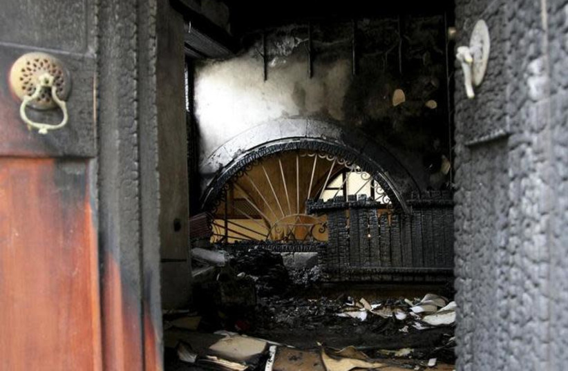 A burnt synagogue at Chania town on the Greek island of Crete (photo credit: REUTERS/GEORGE PAPANIKOLAOU)