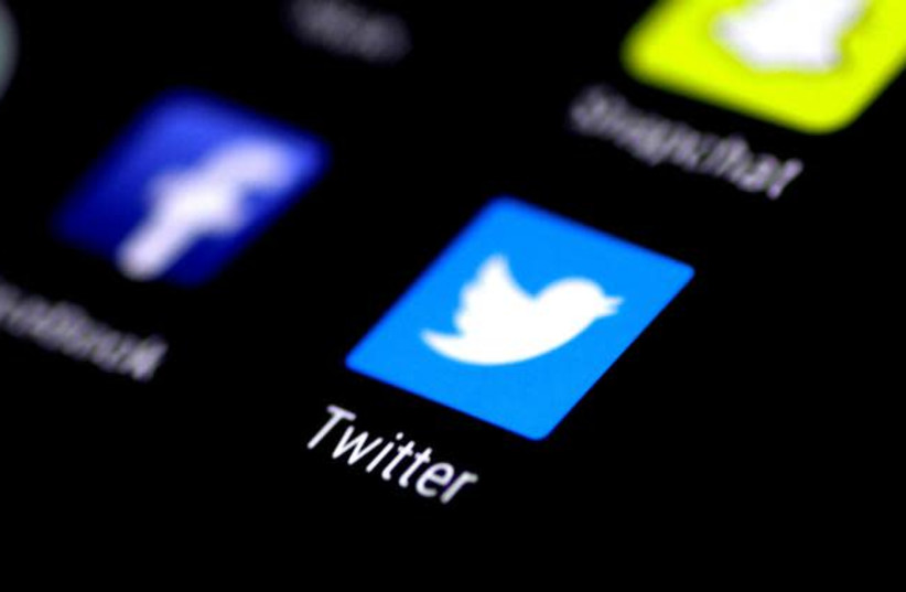 The Twitter application is seen on a phone screen August 3, 2017 (photo credit: REUTERS/THOMAS WHITE)