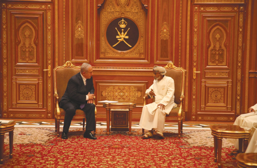 PRIME MINISTER Benjamin Netanyahu meets Sultan Qaboos bin Said in Oman. (photo credit: GPO/REUTERS)