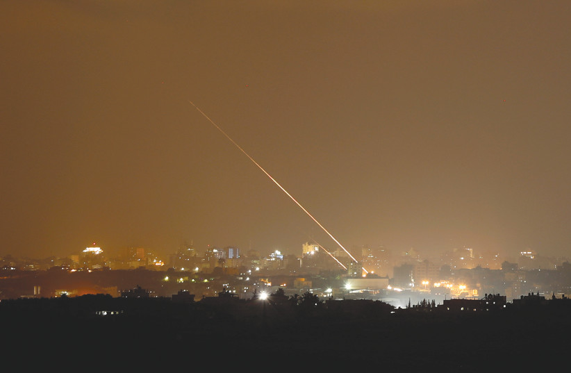 ROCKETS ARE launched from the northern Gaza Strip toward Israel, as seen from Sderot in August (photo credit: AMIR COHEN/REUTERS)