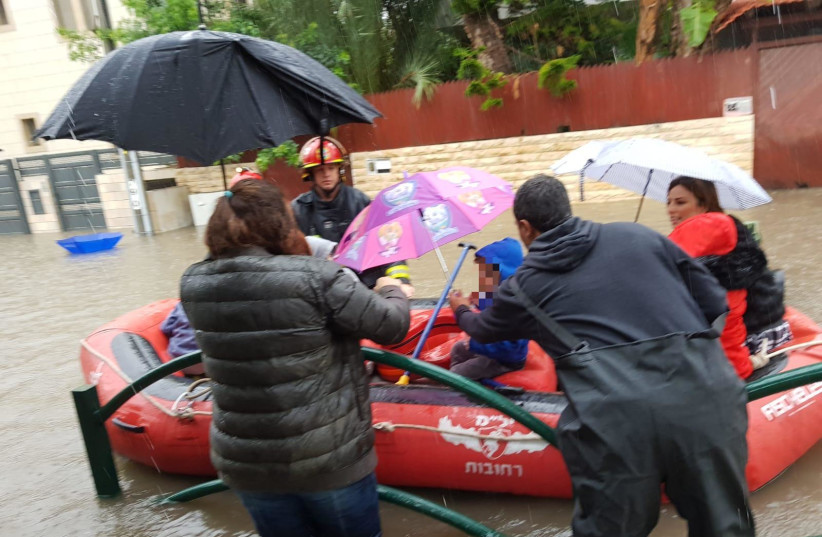 Children are rescued from a flooded kindergarden in Rehovot on December 6, 2018 (photo credit: REHOVOT RESCUE SERVICES SPOKESPERSON)