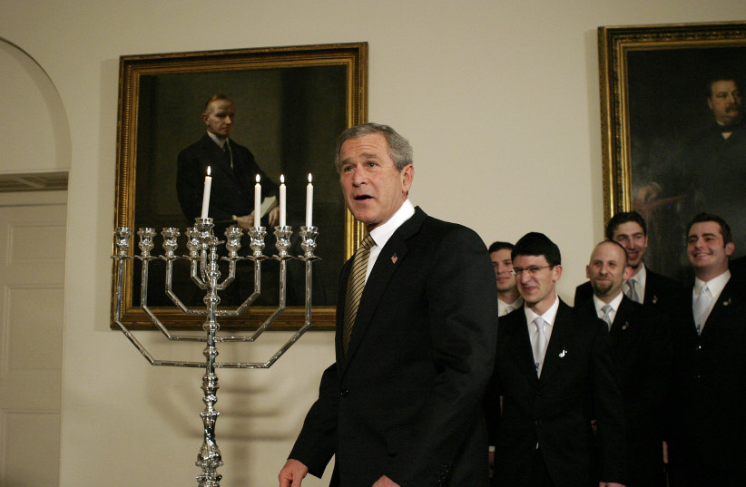 U.S. President George W. Bush looks on after a menorah was lit for Hanukkah at the White House in Washington December 9, 2004 (photo credit: REUTERS/SHAUN HEASLEY SH)