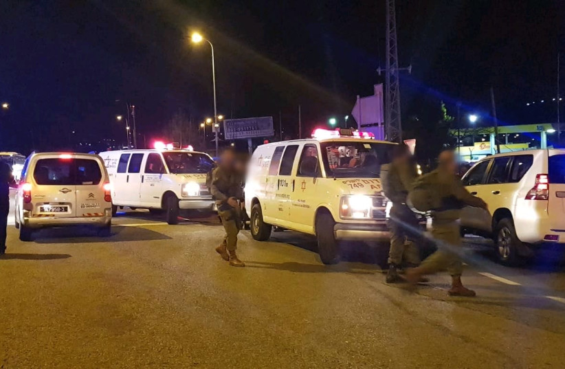 Ambulances gather after six injured in a shooting by Ofra, near Jerusalem. (photo credit: MDA)
