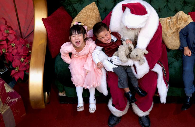 Santa Claus (photo credit: MARK MAKELA / REUTERS)
