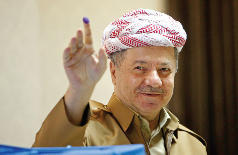 KURDISTAN DEMOCRATIC Party leader Masoud Barzani shows his ink-stained finger after casting his vote during parliamentary elections in the semi-autonomous region on the outskirts of Erbil, Iraq, on September 30. (photo credit: REUTERS)