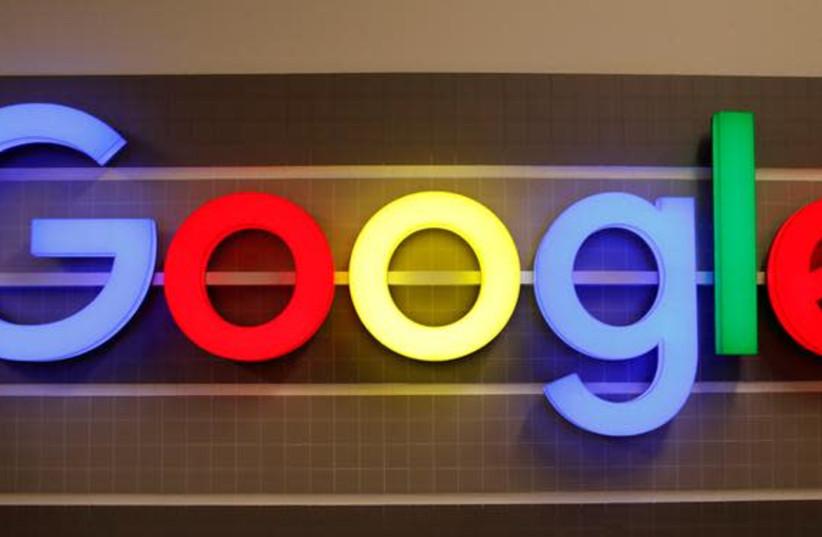 An illuminated Google logo is seen inside an office building in Zurich, Switzerland December 5, 2018. (photo credit: REUTERS/ARND WIEGMANN)