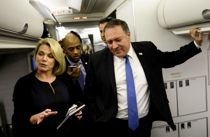 Spokesperson Heather Nauert (L) speaks as U.S. Secretary of State Mike Pompeo dialogues with reporters in his plane while flying from Panama to Mexico, October 18, 2018 (photo credit: BRENDAN SMIALOWSKI/POOL VIA REUTERS)