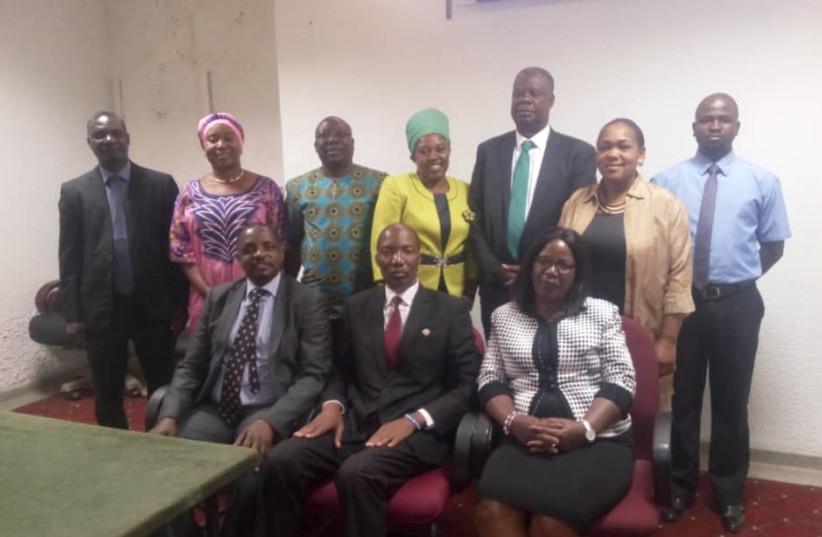 Hon Maxas B Ng'onga( Chairperson ) ,Bishop Scott Mwanza (Caucus External Director) Hon Pilila Jere (Vice Chairperson),Standing: left to right Hon Hastings S Chansa, Hon Patricia Mwashingwele, Hon Ponde  Mecha, Hon Maria Langa, Mr Edie Samakai ( IPWGC Africa ) Hon Chushi Kasanda and Jericho Minyoi (D (photo credit: ZIAPC DESK OFFICER JERICHO MINYOI)