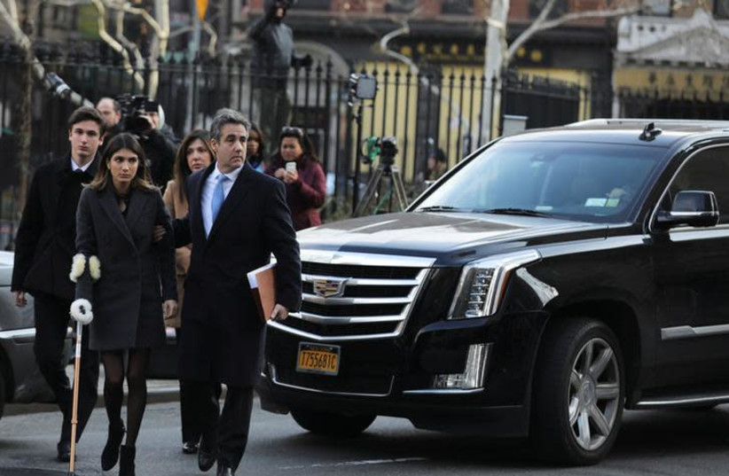 Michael Cohen, U.S. President Donald Trump's former attorney, arrives for his sentencing at United States Court house in the Manhattan borough of New York City, New York, U.S., December 12, 2018 (photo credit: JEENAH MOON/REUTERS)