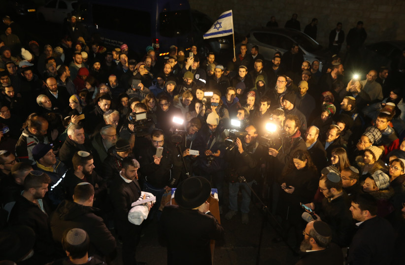 The baby that died after the Ofra attack (bottom left) being laid to rest at the Mount of Olives cemetry, December 12th, 2018 (photo credit: MARC ISRAEL SELLEM/THE JERUSALEM POST)