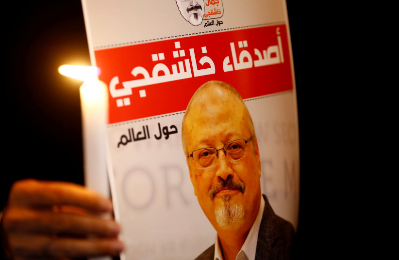 A demonstrator holds a poster with a picture of Saudi journalist Jamal Khashoggi outside the Saudi Arabia consulate in Istanbul, Turkey October 25, 2018. (photo credit: REUTERS/OSMAN ORSAL)