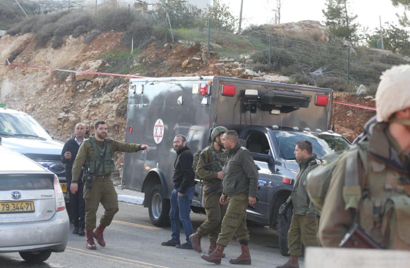 Scene of Givat Asaf shooting attack (photo credit: MARC ISRAEL SELLEM/THE JERUSALEM POST)