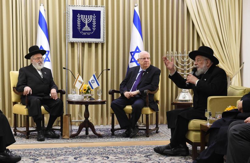 President Reuven Rivlin at a meeting with representatives of Ganzach Kiddush Hashem, December 13th, 2018 (photo credit: Mark Neiman/GPO)