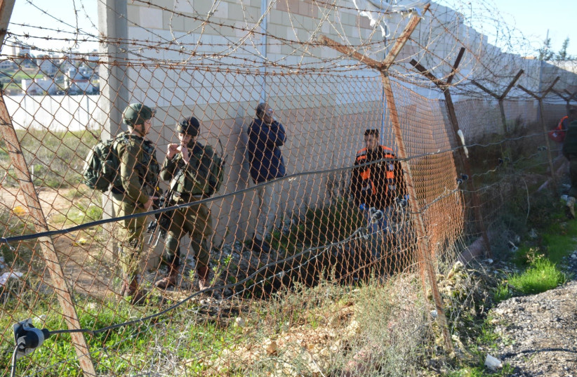 Soldiers and emergency worker gather following clashes between an IDF soldier and a Palestinian who threw a rock at his head  (photo credit: TPS)