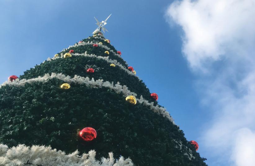 A CHRISTMAS TREE stands at Mar Elias Church for the Christmas-Suta festival  (photo credit: YVETTE J. DEANE)