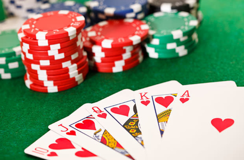 Poker cards and chips (photo credit: HISTORY CHANNEL/WIKIMEDIA COMMONS)
