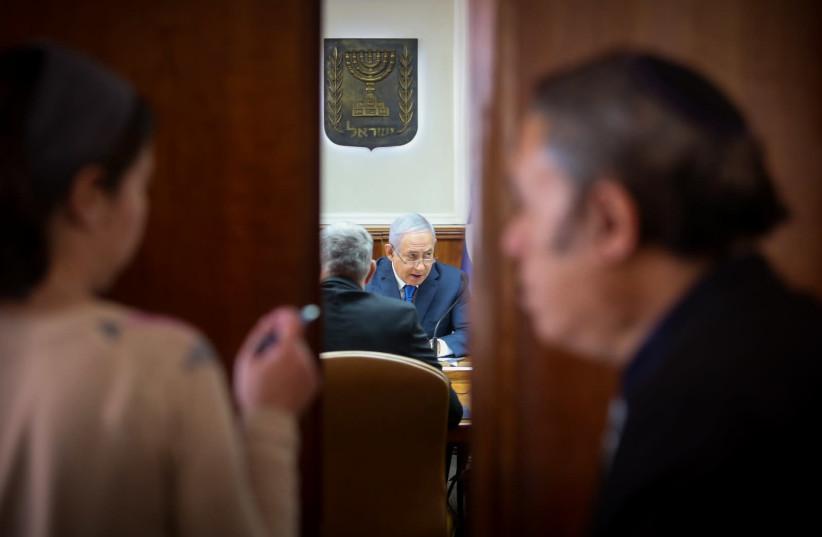 Prime Minister Benjamin Netanyahu at a weekly cabinet meeting, December 16th, 2018 (photo credit: MARC ISRAEL SELLEM/THE JERUSALEM POST)