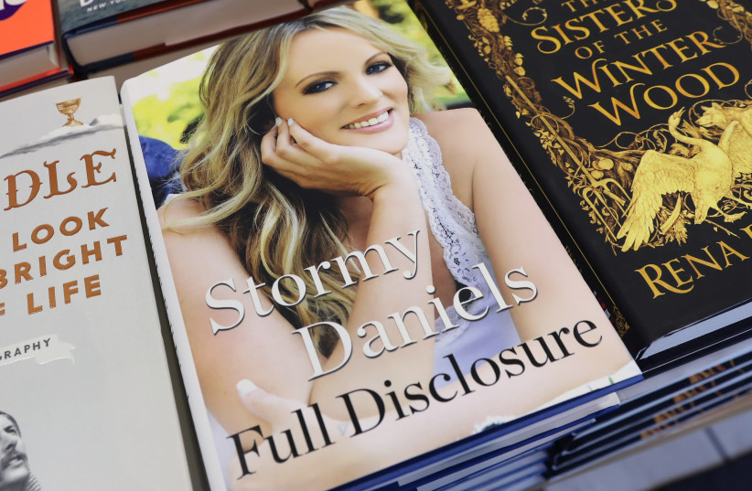 """The book """"Full Disclosure"""" by Stormy Daniels is seen for sale in Manhattan, New York, U.S., October 2, 2018.  (photo credit: SHANNON STAPLETON / REUTERS)"""