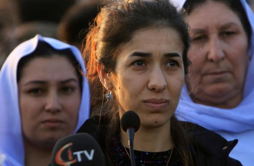 Nobel Peace Prize laureate, Yazidi activist Nadia Murad talks to people during her visit to Sinjar, Iraq December 14, 2018. (photo credit: ARI JALAL / REUTERS)