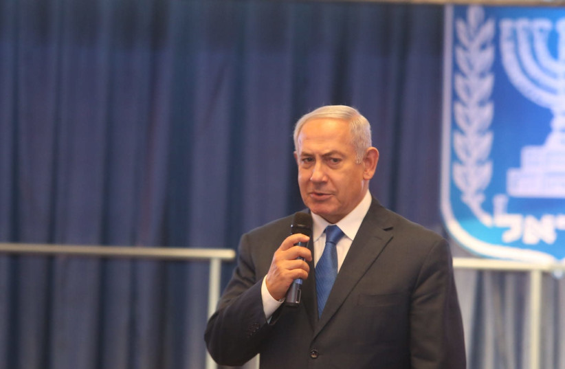 PM Benjamin Netanyahu giving presentation at the Foreign Affairs Ministry, December 16th, 2018. (photo credit: MARC ISRAEL SELLEM)