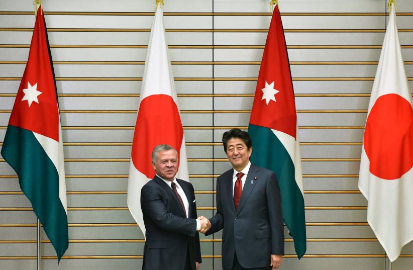 King Abdullah II of Jordan is greeted by Japan's Prime Minister Shinzo Abe prior to their talks at the prime minister's office in Tokyo, Japan November 27, 2018. (photo credit: KAZUHIRO NOGI/POOL VIA REUTERS)