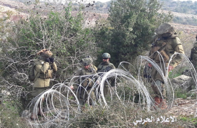 Israeli soldiers set up barbed wire before a confrontation broke out between IDF and Lebanese armed forces (photo credit: HEZBOLLAH TELEGRAM CHANNEL AND AL-MANAR)