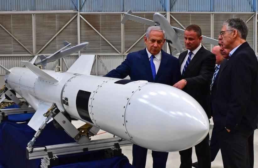 Prime Minister Benjamin Netanyahu inspects a missile at Israel Aerospace Industries. (photo credit: KOBI GIDEON/GPO)