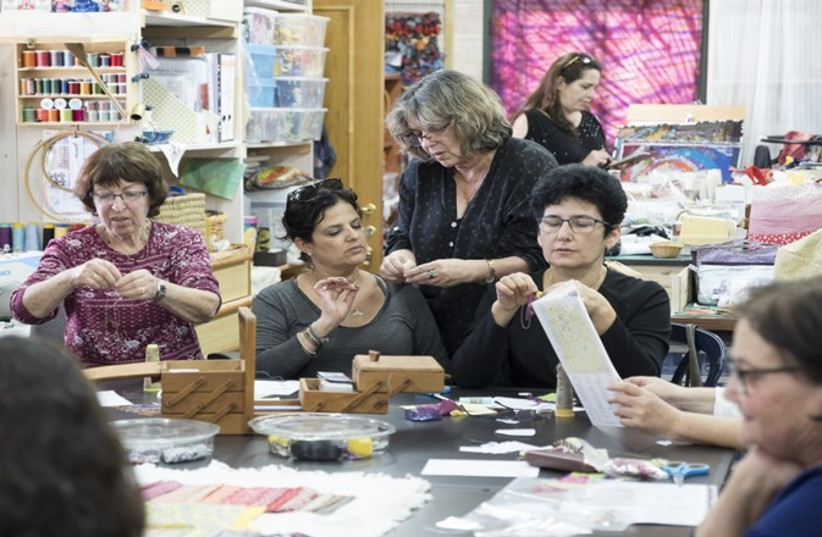 Hasia Naveh leading her quilt-making workshop (photo credit: Courtesy)