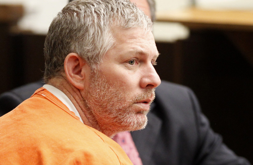 Former Major League baseball player Lenny Dykstra appears in Los Angeles Superior Court for an arraignment in San Fernando, California August 8, 2011. Dykstra is charged with 25 counts, including grand theft auto and possession of a controlled substance. (photo credit: DANNY MOLOSHOK/ REUTERS)