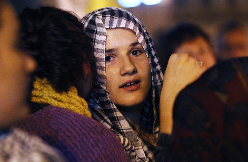 A woman attends a pro-Palestine march through central Sydney May 15, 2012.  (photo credit: DANIEL MUNOZ / REUTERS)