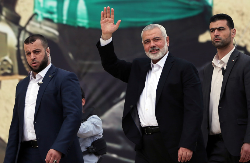 Hamas Chief Ismail Haniyeh gestures during a rally marking the 31st anniversary of Hamas' founding, in Gaza City December 16, 2018 (photo credit: IBRAHEEM ABU MUSTAFA / REUTERS)