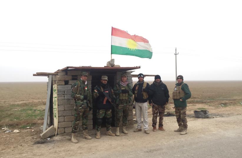 Rojava Peshmerga guard a road in northern Iraq in December 2015 (photo credit: SETH J. FRANTZMAN)