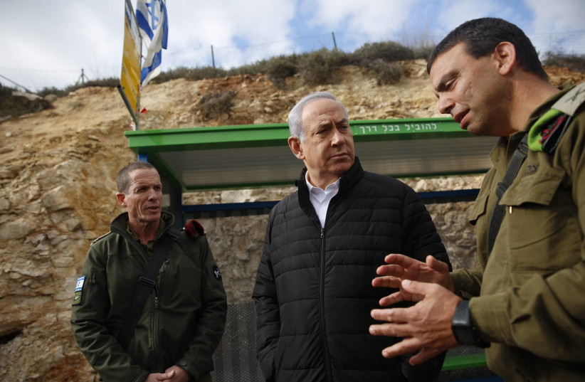 Prime Minister Benjamin Netanyahu at the site of terror attack near Bet El, December 18, 2018 (photo credit: TOMER APPELBAUM)