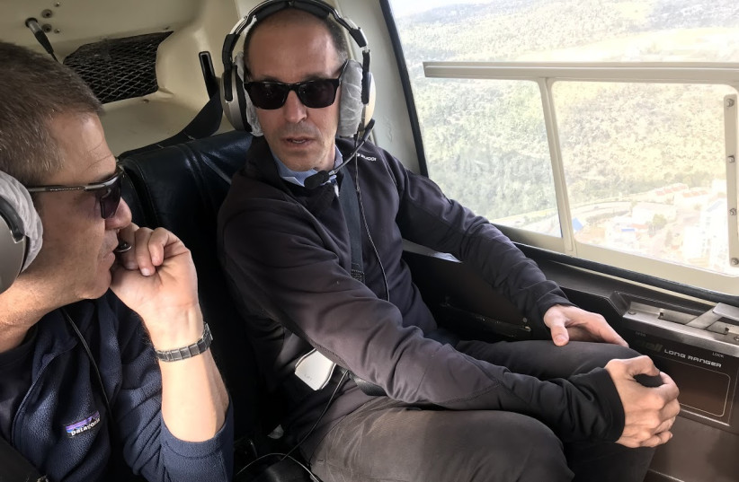 Airbnb Vice-President Chris Lanahan on a helicopter tour of the West Bank, December 18, 2018 (photo credit: COURTESY THE ISRAELI PROJECT)