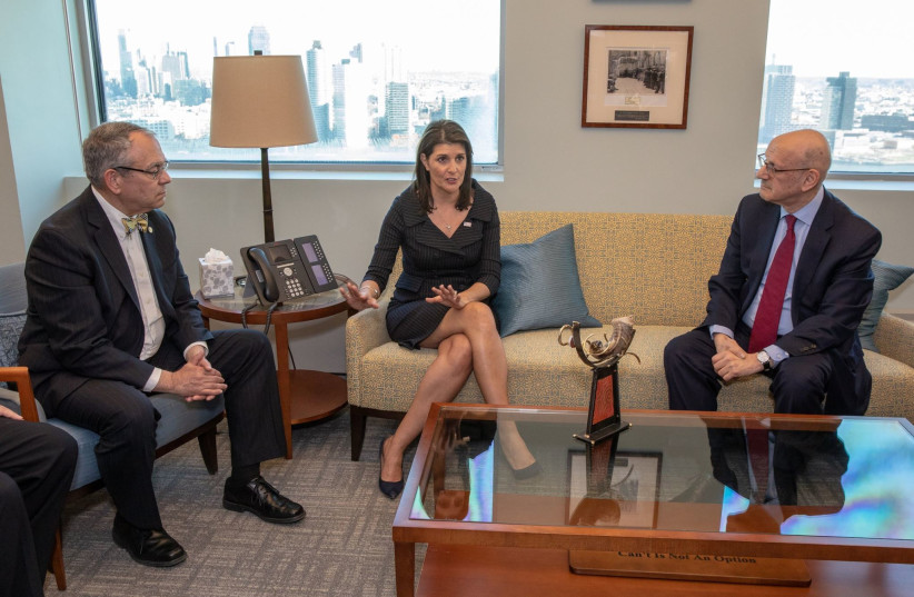 B'nai B'rith International President Charles O. Kaufman and CEO Daniel S. Mariaschin speak with Nikki Haley at the private event held at the United States Mission to the United Nations located in New York (photo credit: B'NAI B'RITH INTERNATIONAL)