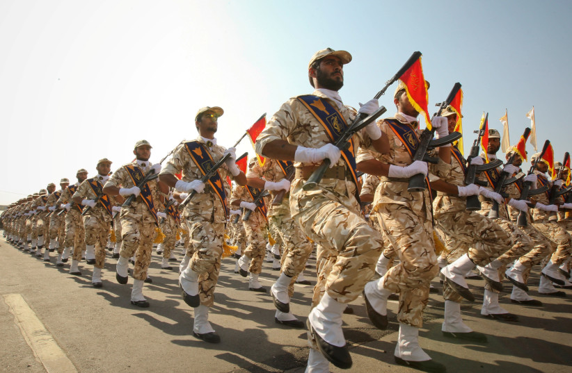 Members of the Iranian Revolutionary Guards march during a parade to commemorate the anniversary of the Iran-Iraq war (1980-88), in Tehran September 22, 2011. (photo credit: REUTERS/STRINGER)