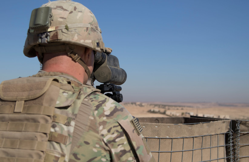 A U.S. Soldier surveils the area during a combined joint patrol in Manbij, Syria, November 1, 2018. Picture taken on November 1, 2018. (photo credit: COURTESY ZOE GARBARINO/U.S. ARMY/HANDOUT VIA REUTERS)