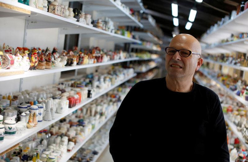 Eitan Bar-on stands next his collection of 37,000 pairs of shakers, displayed in a shack at the backyard of his home in Hadera, Israel December 12, 2018. Picture taken December 12, 2018. (photo credit: REUTERS/NIR ELIAS)