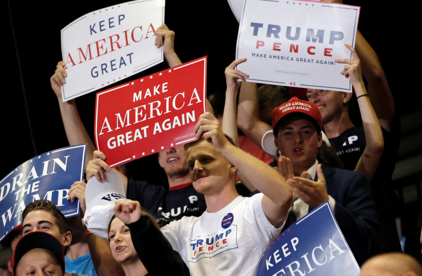 Supporters of U.S. President Donald Trump attend a rally in Springfield, Missouri, September 21, 2018. Picture taken September 21, 2018 (photo credit: REUTERS/MIKE SEGAR)