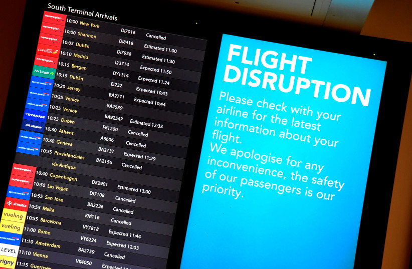 An arrivals board in the South Terminal building at Gatwick Airport, after the airport reopened to flights following its forced closure because of drone activity, in Gatwick, Britain, December 21, 2018 (photo credit: TOBY MELVILLE/REUTERS)