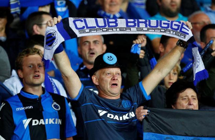 Club Brugge v Borussia Dortmund - Club Brugge fan holds up a scarf before the match, September 18, 2018. (photo credit: REUTERS/FRANCOIS LENOIR)