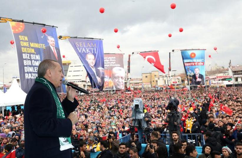Turkish President Tayyip Erdogan addresses his supporters in Konya, Turkey, December 17, 2018. (photo credit: REUTERS ATTENTION EDITORS)