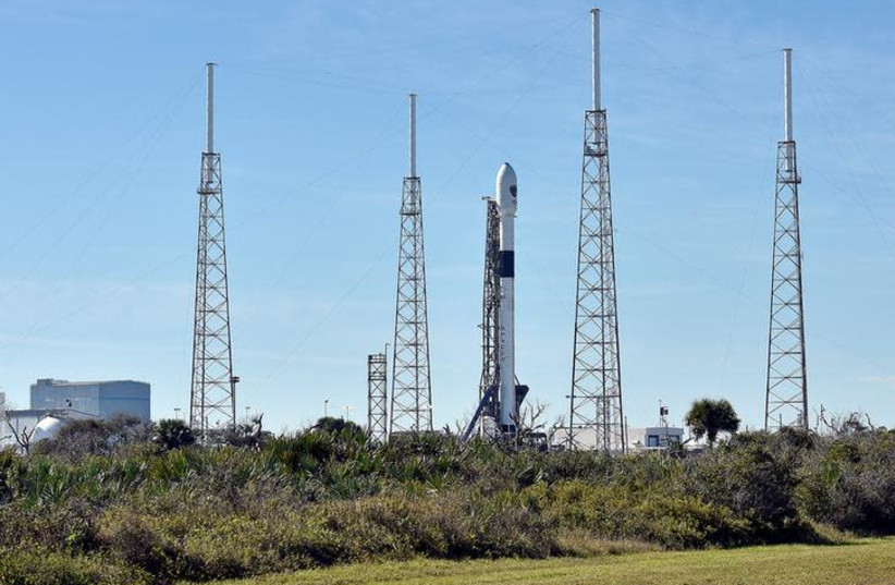 The SpaceX Falcon 9 rocket, scheduled to launch a U.S. Air Force navigation satellite, sits on Launch Complex 40 after the launch was postponed after an abort procedure was triggered by the onboard flight computer, at Cape Canaveral, Florida, U.S. (photo credit: REUTERS/STEVE NESIUS)