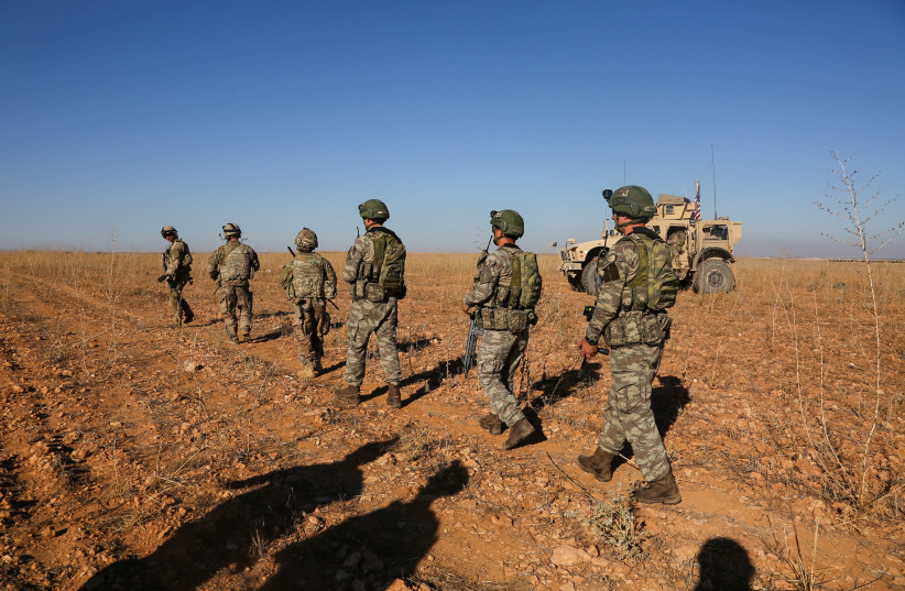 U.S. and Turkish soldiers conduct the first-ever combined joint patrol outside Manbij, Syria, November 1, 2018. Picture taken November 1, 2018. Courtesy Arnada Jones/U.S.  (photo credit: ARMY/HANDOUT VIA REUTERS)