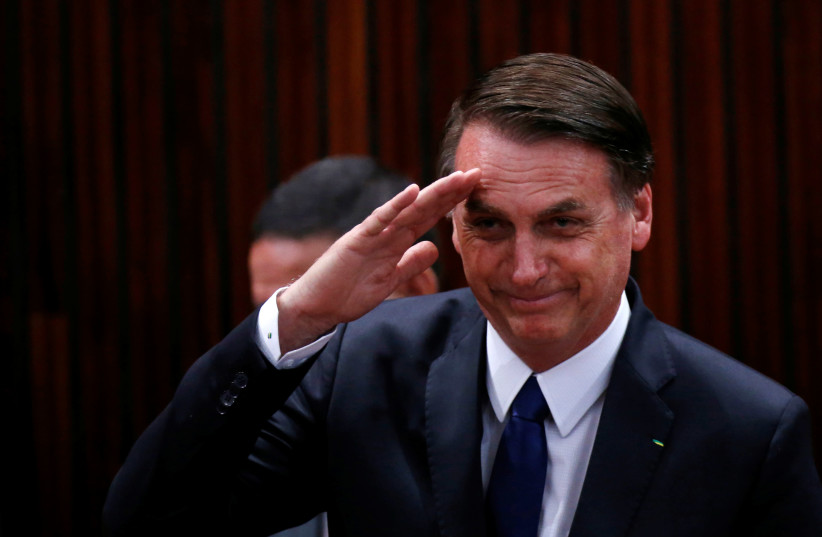 Brazil's President-elect Jair Bolsonaro salutes before receiving a confirmation of his victory in the recent presidential election in Brasilia, Brazil December 10, 2018 (photo credit: ADRIANO MACHADO/ REUTERS)