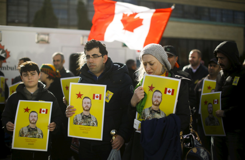 Mourners hold photos of John Gallagher, a Canadian volunteer fighter and former Canadian forces member who was killed fighting alongside Kurdish forces in Syria against the Islamic State, in Toronto, November 20, 2015 (photo credit: REUTERS)